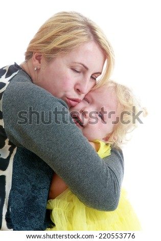 affectionate mother comforting her crying daughter isolated on white background.The concept of development of the child, the child's upbringing. - stock photo