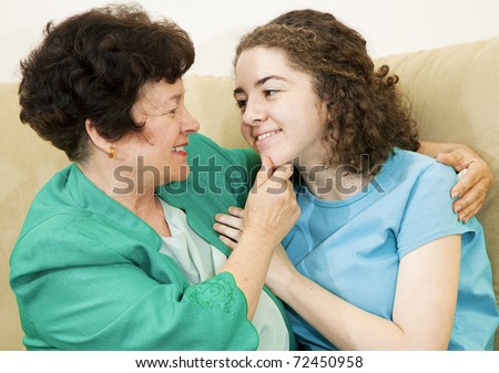 Affectionate mother together with her loving teenage daughter.
