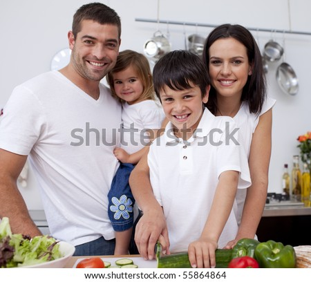 Affectionate young family cooking together in the kitchen