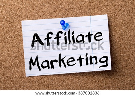 Affiliate Marketing - teared note paper pinned on bulletin board - horizontal image - stock photo