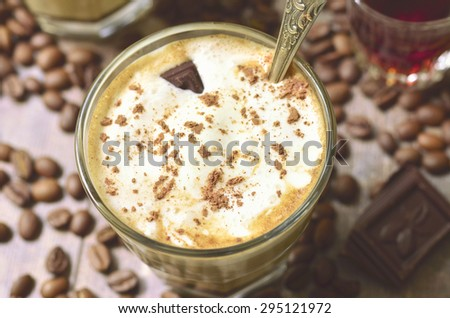 Affogato - traditional italian coffee dessert with ice cream and amaretto.