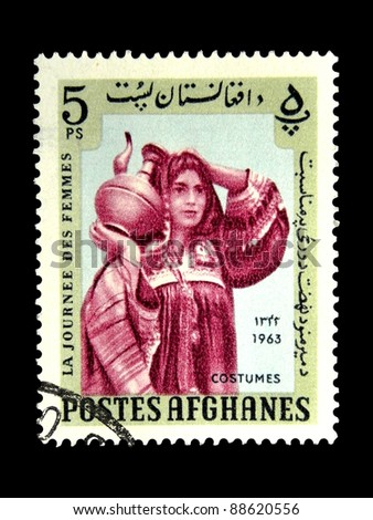 "AFGHANISTAN - CIRCA 1963: A stamp printed in Afghanistan shows Woman in the Afghan national dress with the inscription ""Costumes"" from the series ""Womens Day"", circa 1963"