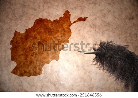 Afghanistan map on vintage paper with old pen - stock photo