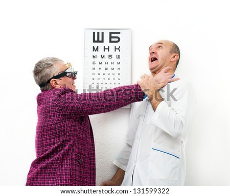 Afraid doctor and crazy patient - stock photo