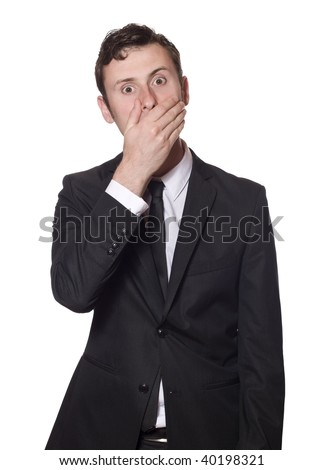 afraid looking businessman in a black suite isolated on white - stock photo