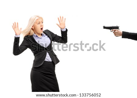Afraid young businesswoman from a gun isolated on white background - stock photo