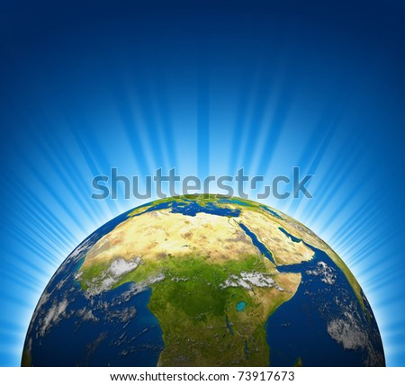 Africa and the Middle east view on an Earth planet globe model with a bright radial blue background. - stock photo