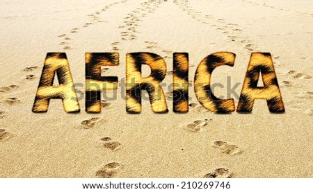 Africa fur leopard text isolated on beach sand background - stock photo