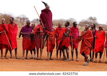 AFRICA, KENYA, MASAI MARA - JULY 2: Masai warriors dancing traditional jumps as cultural ceremony near to Masai Mara National Park Reserve, July 2,2011,Kenya - stock photo