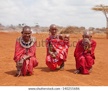AFRICA, KENYA, MASAI MARA - JULY 2: unidentified Female tribal members wearing traditional attire posing for a portrait on July 2,2011, in Kenya - stock photo