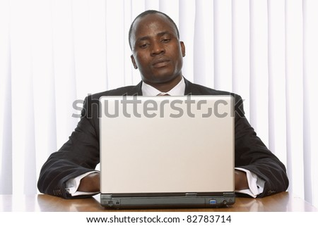 african amercian businees man working on his laptop - stock photo