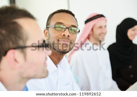 African american Arabic business man in a row with colleagues