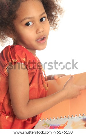 African American Asian black child reads a book isolated metisse - stock photo