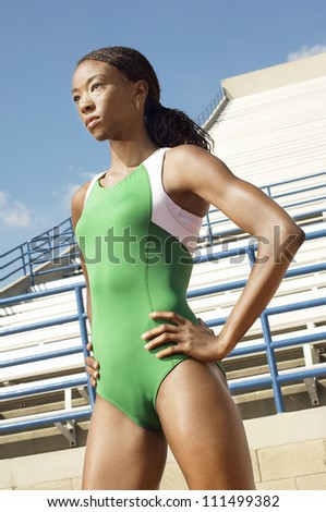 African American athlete woman in sportswear with hands on hips - stock photo