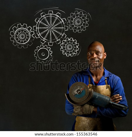 African American black man industrial worker with chalk gears on a blackboard background - stock photo