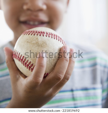 African American boy holding baseball - stock photo
