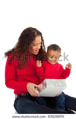 African American Boy Open Christmas Gift Box with Mom - stock photo