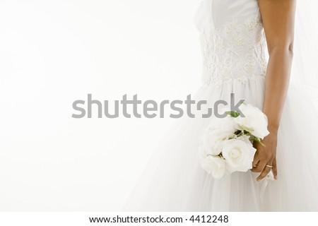 African-American bride holding bouquet. - stock photo