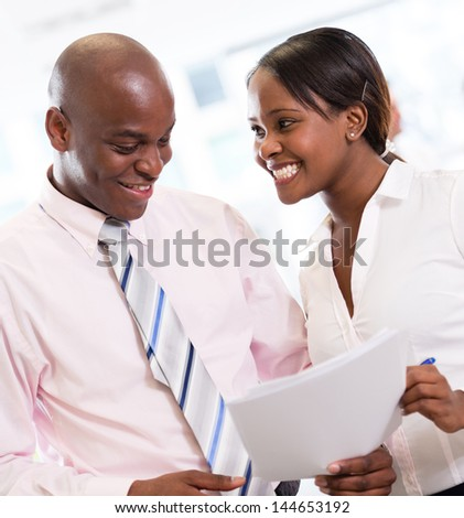 African american business couple working at the office - stock photo