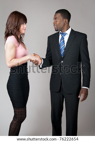African American business man meeting a female colleague. - stock photo