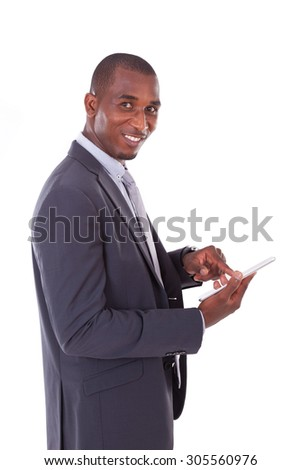 African american business man using a tactile tablet over white background - Black people