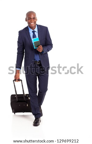 african american business traveller walking on white - stock photo