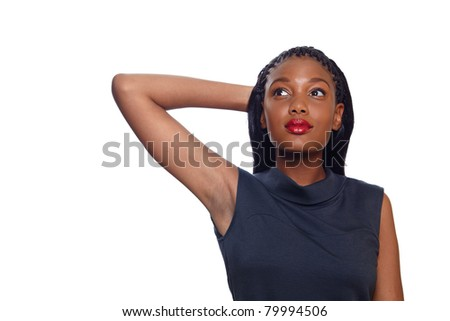 African American business woman holds her arm behind her head and dreaming while looking up over white background with copy space