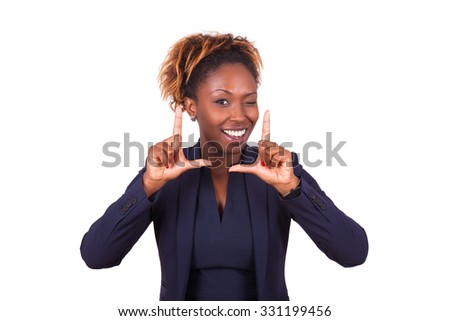 African American business woman making frame gesture with her hands, isolated on white background - stock photo