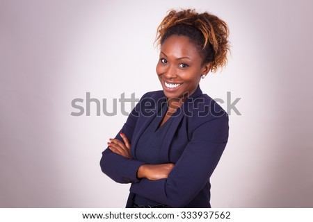 African American business woman portrait, isolated on gray background
