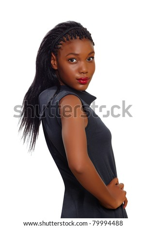 African American business woman stands confident with arms on her side and looking over her shoulder on white background - stock photo