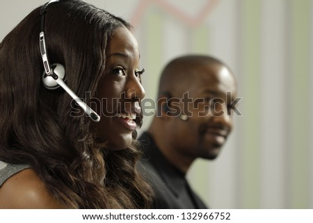African American business woman taking a sales call using a headset - stock photo