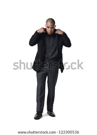 African American businessman adjusting his jacket against white background, - stock photo
