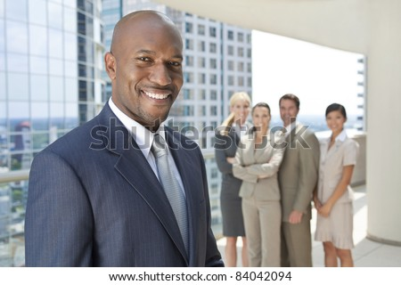 African American businessman and an interracial group of business men & women, businessmen and businesswomen team - stock photo