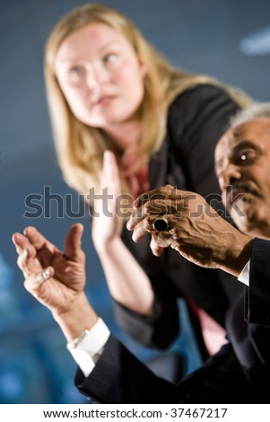 African American businessman and female assistant in a boardroom meeting - stock photo