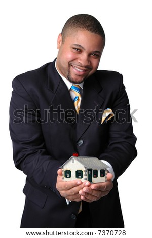 African American businessman holding a house representing home ownership.