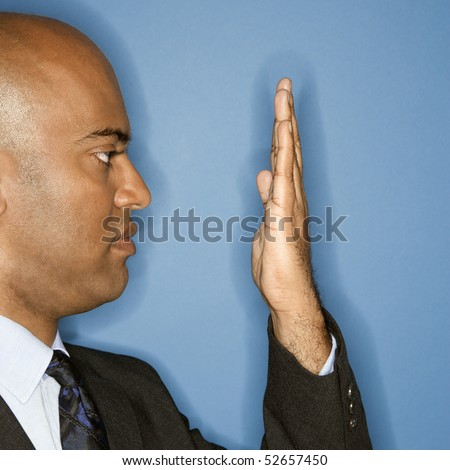 African American businessman holding hand in front of face. - stock photo