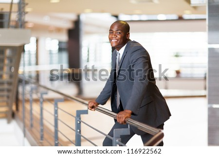 african american businessman in modern office building - stock photo