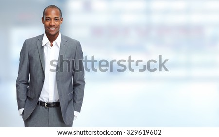 African-American Businessman over blue banner background - stock photo