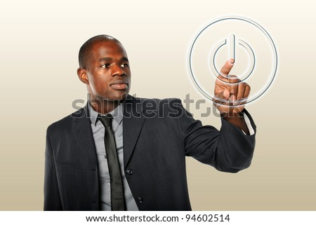 African American businessman touching power button