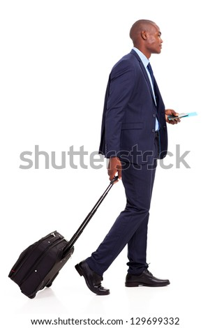 african american businessman walking with trolley bag on white - stock photo