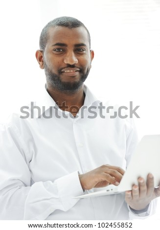 African American businessman with a laptop - stock photo