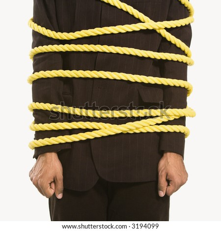 African American businessman wrapped in yellow rope. - stock photo