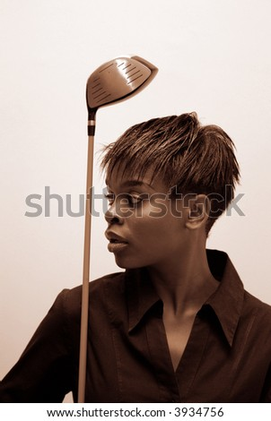 African American businesswoman in sepia with golf wood club - stock photo