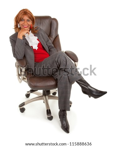 African American Businesswoman Sitting on a Leather Chair - stock photo