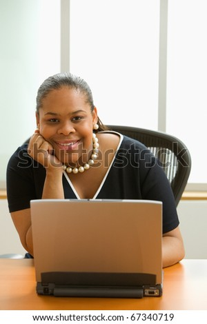 African American businesswoman sitting with laptop - stock photo