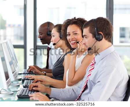 African-American businesswoman working in a call center with her colleagues - stock photo