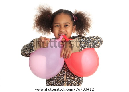 African American child and asian long hair with ball in mouth isolated metisse - stock photo