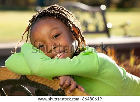 African American child enjoying nice sunny day - stock photo