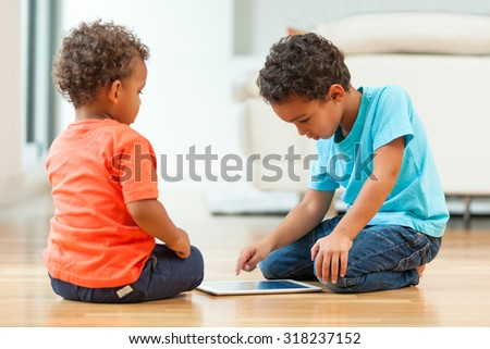 African american childrens using a tactile tablet - stock photo