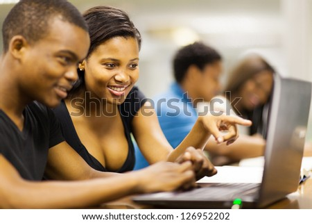 african american college students using laptop computer - stock photo